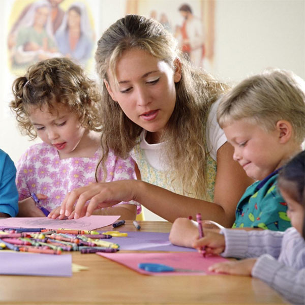 Therapist and children in group play therapy session