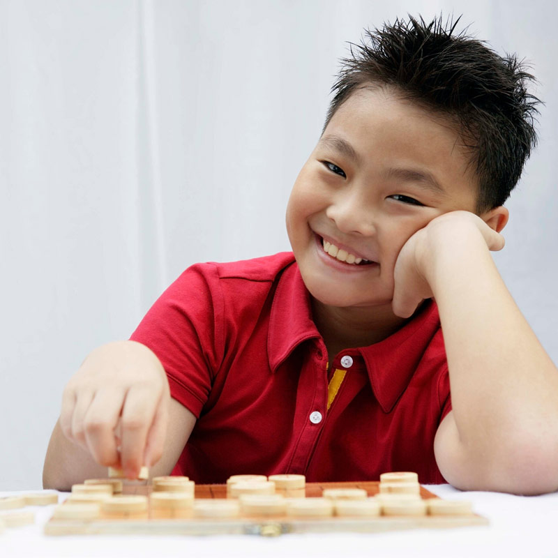 Child playing a board game